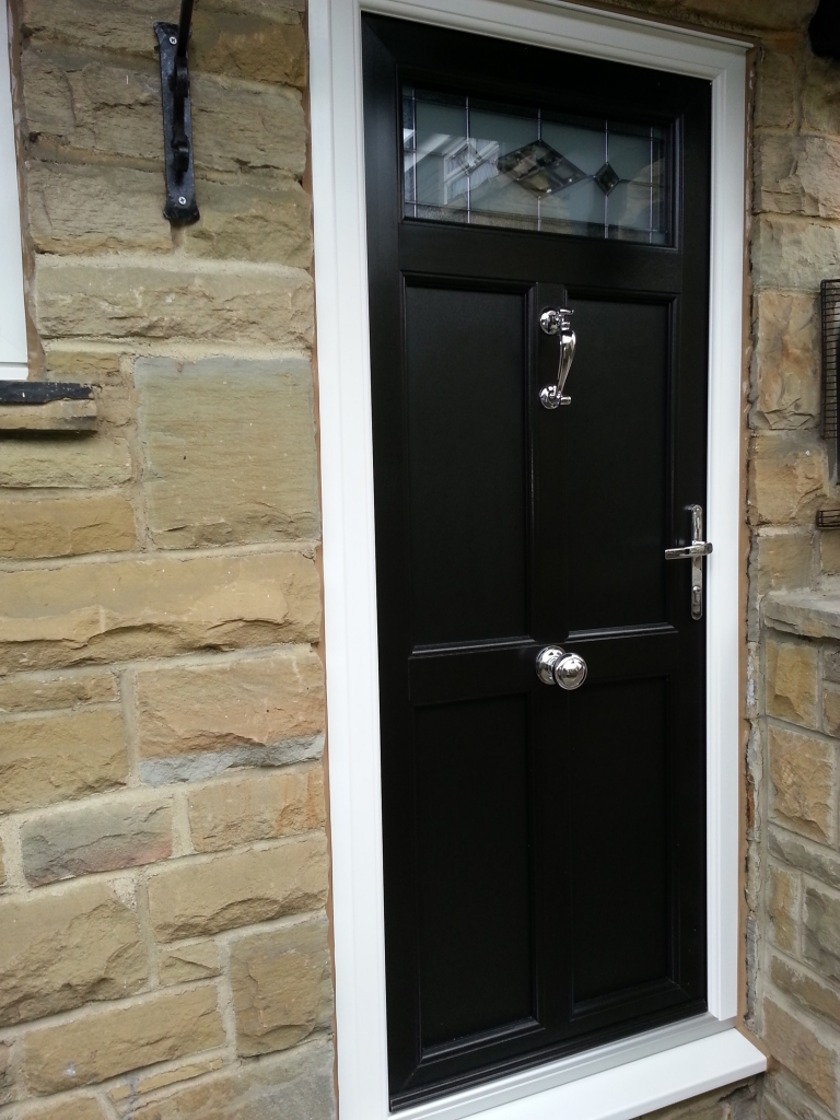 """Sprayed jet black """"engineered"""" door. Triple glazed bevelled unit to top - triple glazed for bevel protection and NOT upgraded thermal performance I might add ;-) heavy duty solid chrome door pull and door knocker."""