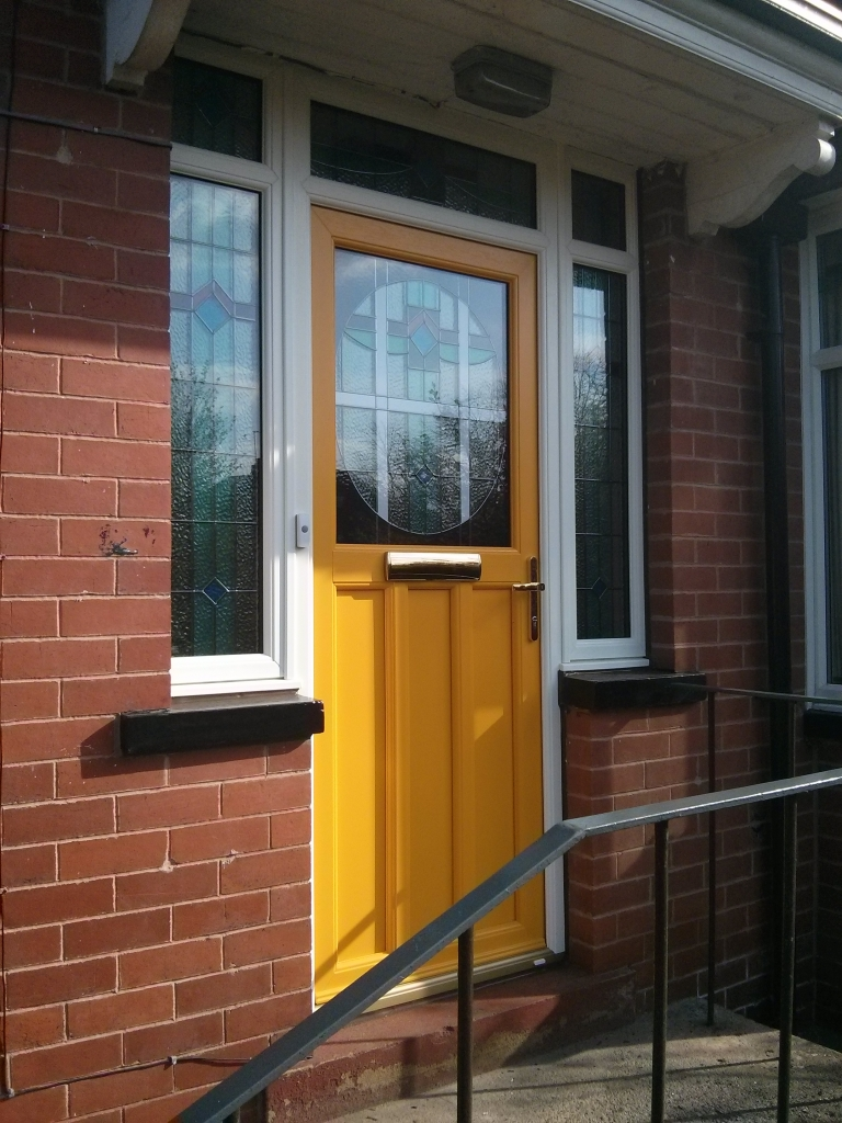 This is a different view. It took nearly 3 months to get this design to replicate the look of their old door and side lights as close as possible. We event copied the existing glass designs from the door, top lights and side lights into new triple glazed units. I think we did a pretty good job!