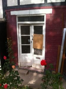 Old wood door and top light